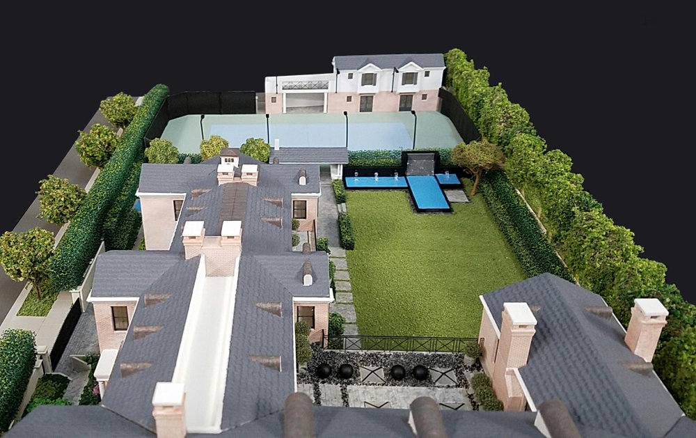 An architectural model of the home, showing the roof well (bottom left), yard, tennis court, and guest house (top right). Model by Glenn R. Johnson Scale Models & Animations .